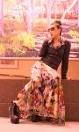 Evelina Galli sitting in Black Leather Jacket